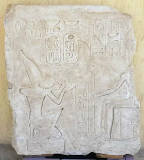 A stone block of King Ramses II in front of Ra Horakhty.