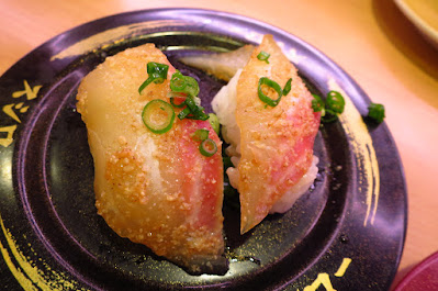 Sushiro, marinated sesame snapper nigiri