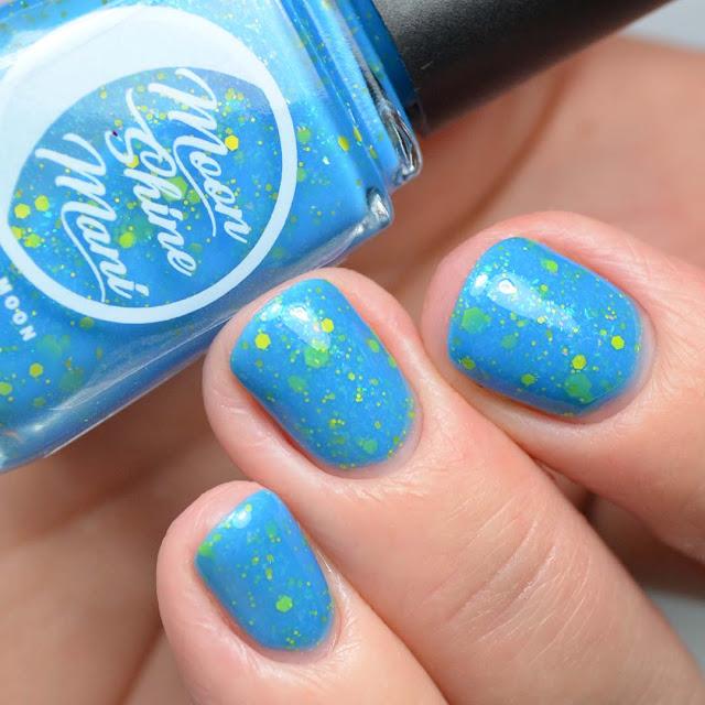 bright blue glitter nail polish swatch