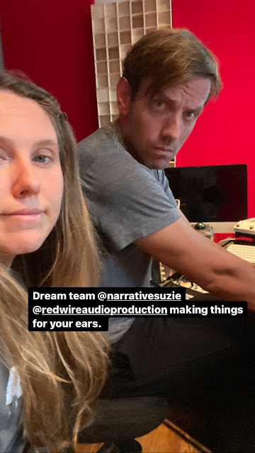 Suzie and Bryan (white guy with blond hair) in a room with red wall using a computer and it says 'dream team @narrativesuzie @redwireaudioproduction making things for your ears'