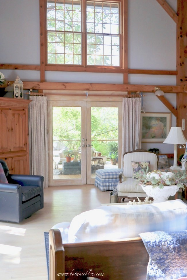 french inspired vaulted fall living room in a post and beam house