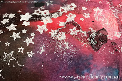 a galaxy background made using Distress Spray Stains and Embossing Powders by Jenny James