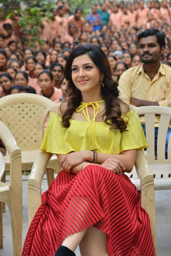 Mehreen Kaur in Spicy Loose Yellow Shirt and Lovely Red Transparent Skirt at Jaawan Movie Promotions at College
