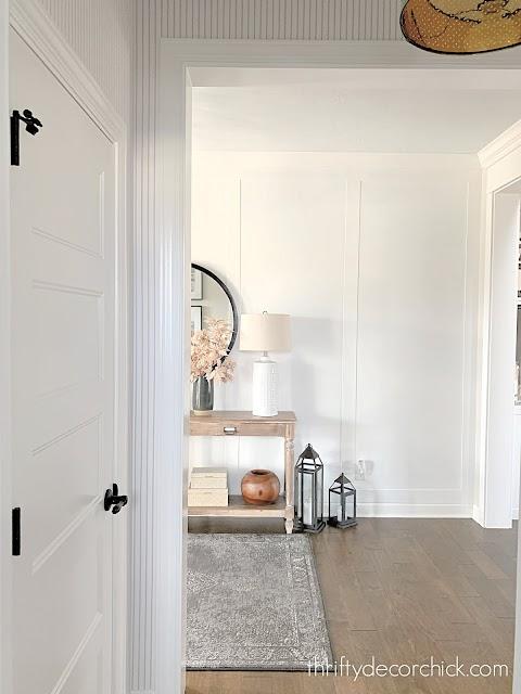 pinstripe wallpaper and wall trim foyer