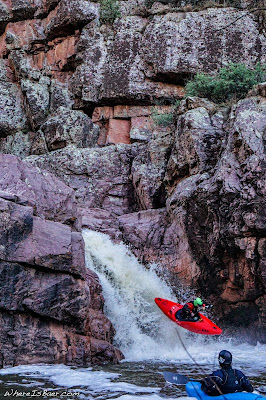 Austin Woody enjoying some air time in Christopher Creek, Arizona kayaking waterfall WhereIsBaer.com Chris Baer