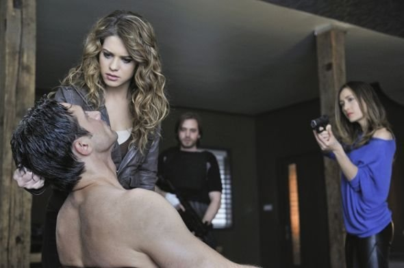 Nikita - Sean (Dillon Casey) hair pulled back by Alex (Lyndsy Fonseca), Nikita (Maggie Q) points gun at Sean, Birkhoff (Aaron Stanford) stands in background
