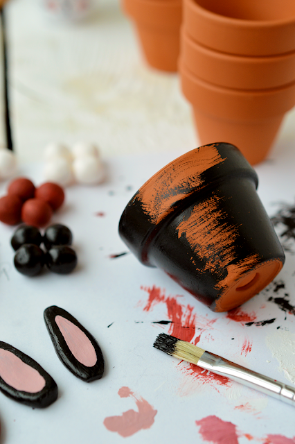 Painting mini planters with acrylic paint