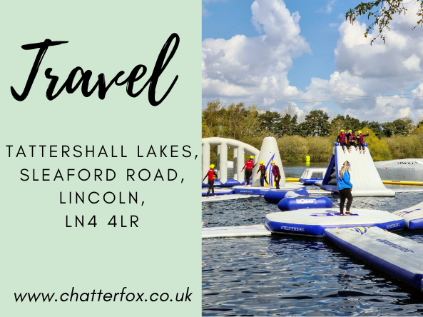 Image title reads 'Travel, Tattershall Lakes, Sleaford Road, Lincoln, LN4 4LR www.chatterfox.co.uk. image to the right of the title shows the Aqua Park Inflatable Assault Course that is available to do at Tattershall Lakes. The image shows people wearing wet suits and life jackets climbing on the inflatable. Image also shows members of staff ensuring Covid 19 restrictions are being adhered to.