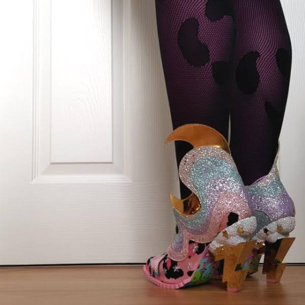back angle of legs showing lightning bolt heeled shoes