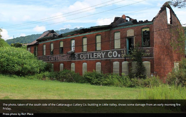 Fire damage to roof, exterior facade still standing, Cattaraugus Cutlery after August 2015 fire