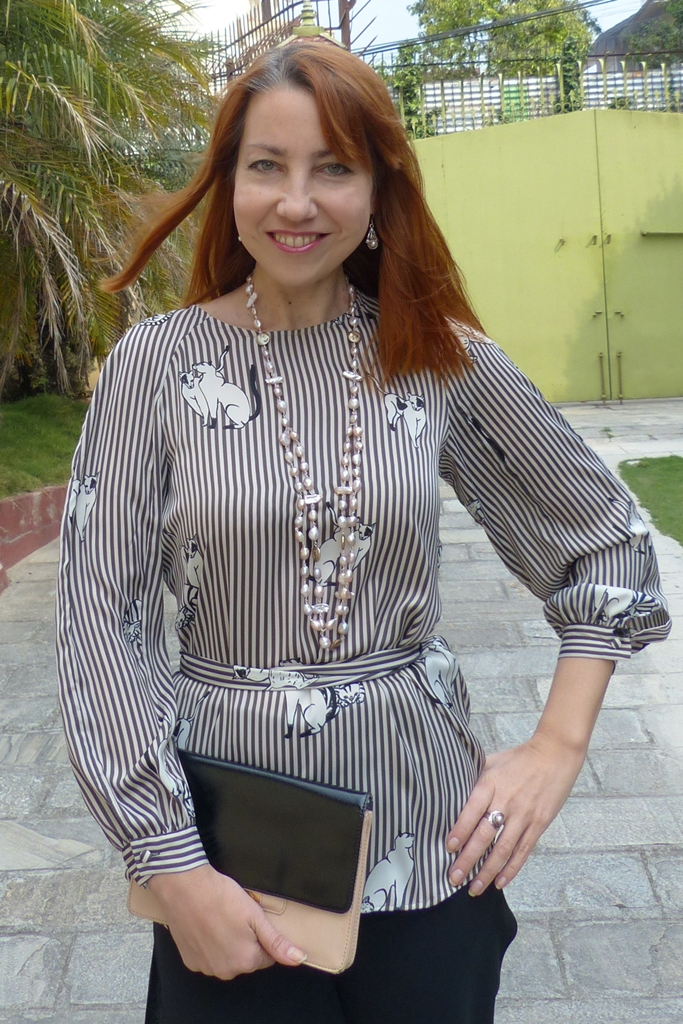 cats and stripes blouse worn with river pearls necklace