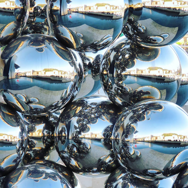 What to see in Bilbao in winter: metal sphere sculpture outside the Guggenheim Bilbao