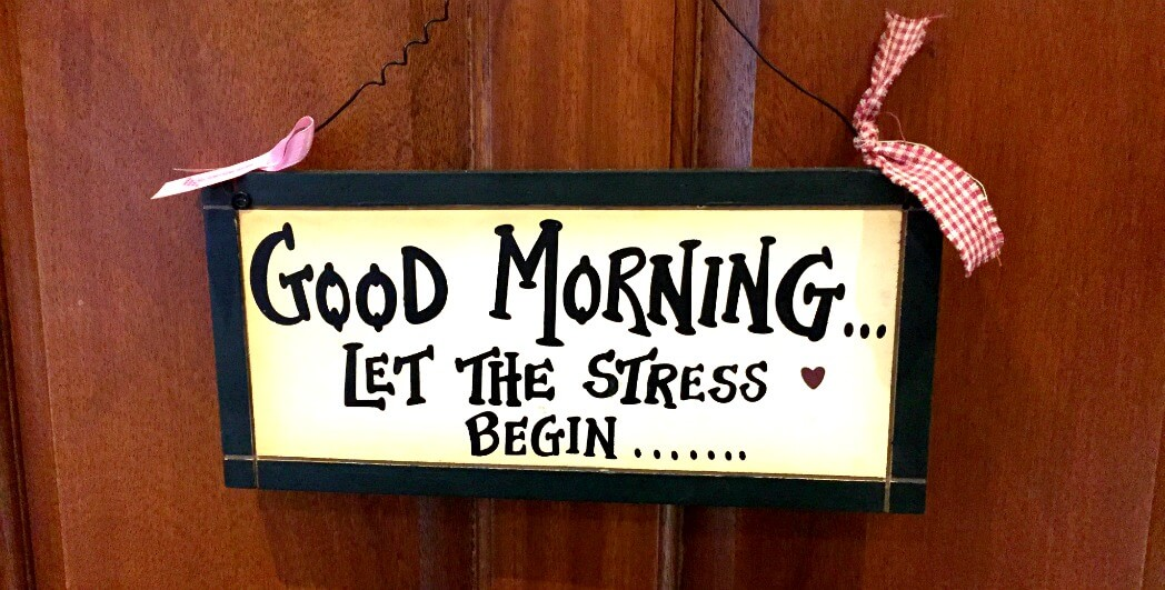 "A plaque that says ""Good Morning, Let the stress begin..."""