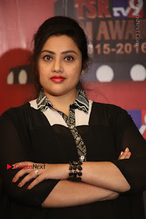 Tamil Actress Meena Latest Stills in Black Dress at TSR TV9 Awards Press Meet  0129.JPG