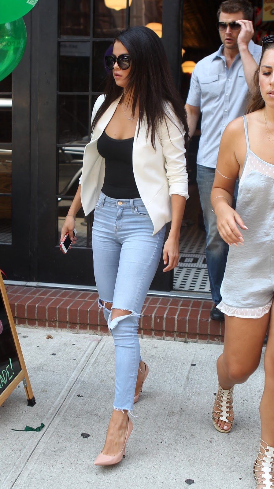 bc462c5c As much as I love Selena wearing her dresses, I love her off duty style  too. The casual ripped jeans and black tank top are basic and are glammed  up ...