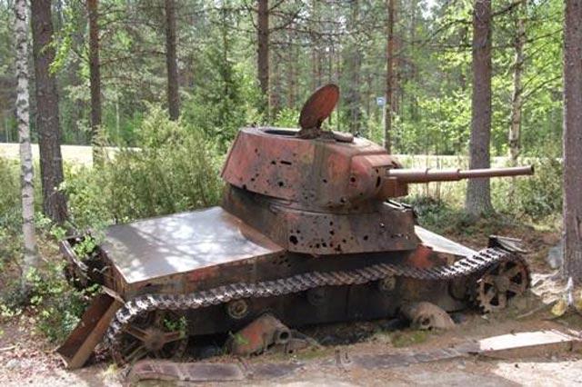 Wrecked Soviet T-26 tank, 11 December 1939 worldwartwo.filminspector.com