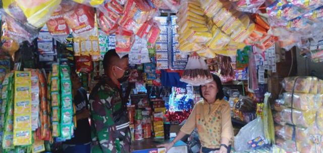 Tepatnya DI Pasar Dwi Kora, Personel Jajaran Kodim 0207/Simalungun Laksanakan Penegakan Disiplin Protkes