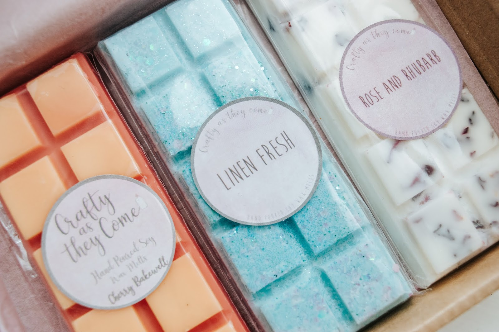 Three wax melts bar in a cardboard box