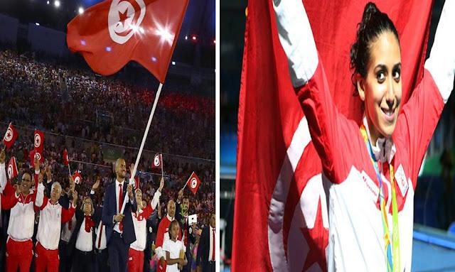 إيناس البوبكري ومهدي بالشيخ يحملان علم تونس في افتتاح الاولمبياد طوكيو 2020
