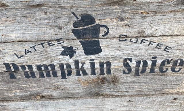 Photo of a pumpkin spice latte stencil on barn wood.