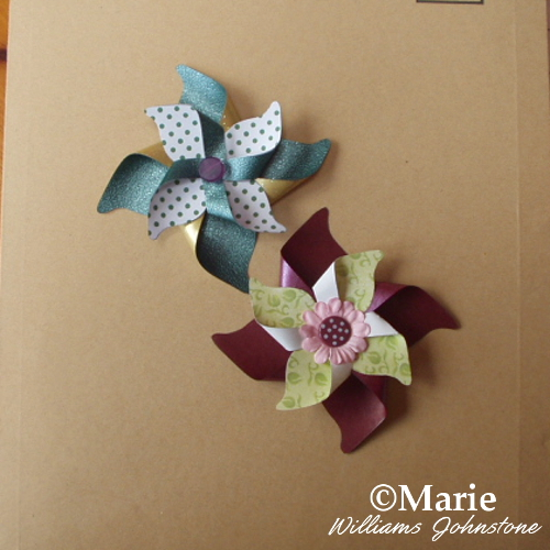 Completed paper pinwheel flowers craft tutorial to follow along with photos how to make paper pinwheels for cards scrapbooks crafts diy