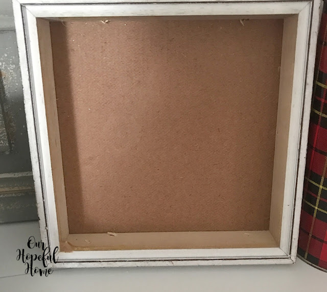 thrifted white frame shadow box