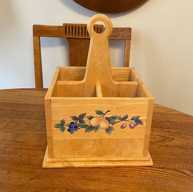 Photo of wooden silverware caddy.