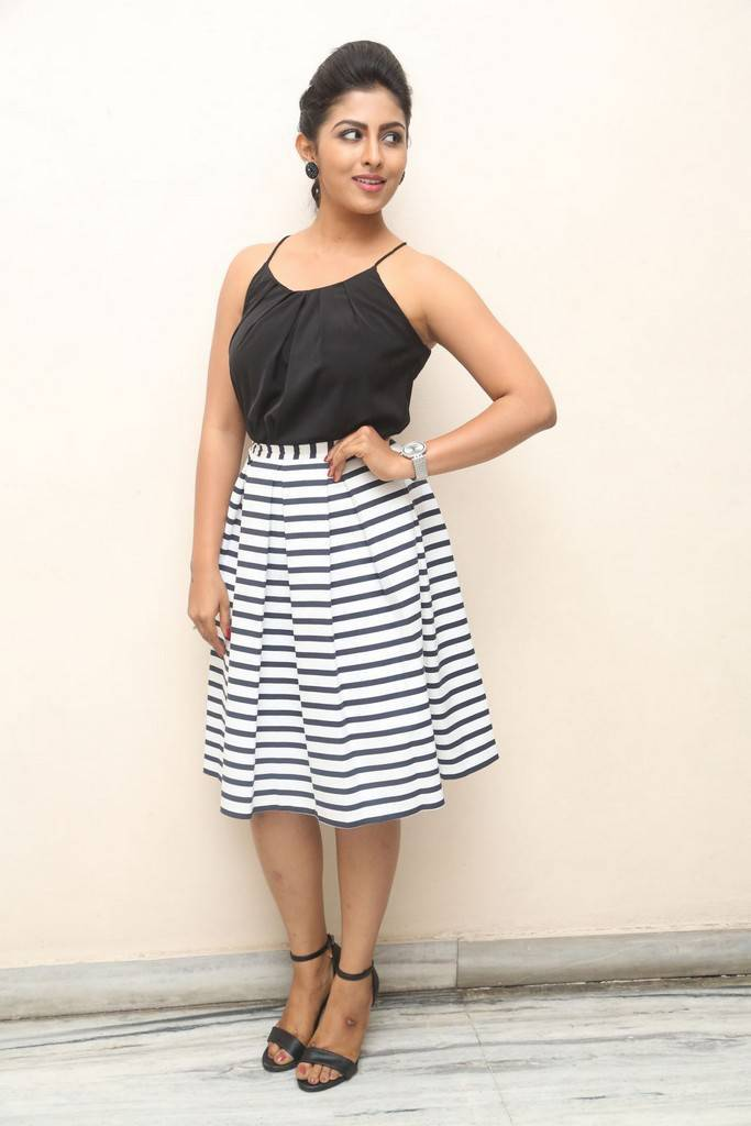 Kruthika Stills In Black Skirt At Movie Success Meet