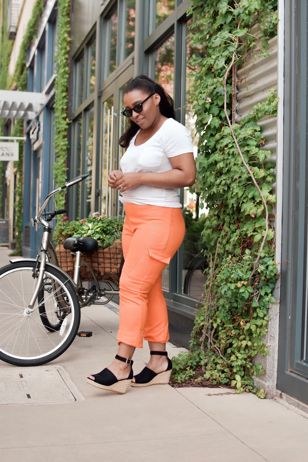 Femme luxe, luxe gal, cargo pants, crocodile print pants, orange pants, summer outfit ideas, animal print pants, wedges