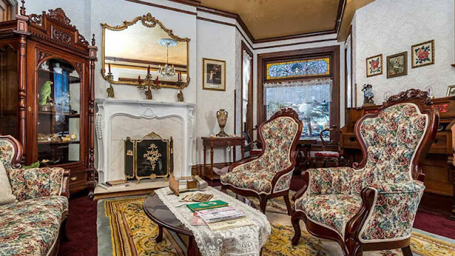 Victorian chairs and fireplace