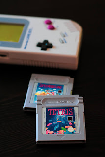 handheld game consoled with a Tetris game cartridge
