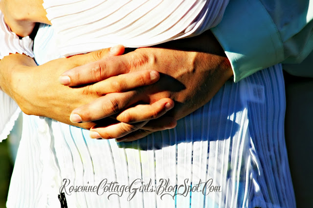 photo of hands of a couple hugging mourning the loss of their infant. | infant loss | Trisomy 13 | rosevinecottage.com