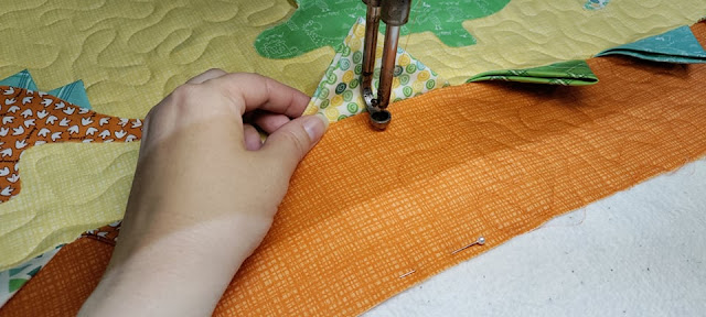 Free motion quilting with prairie points