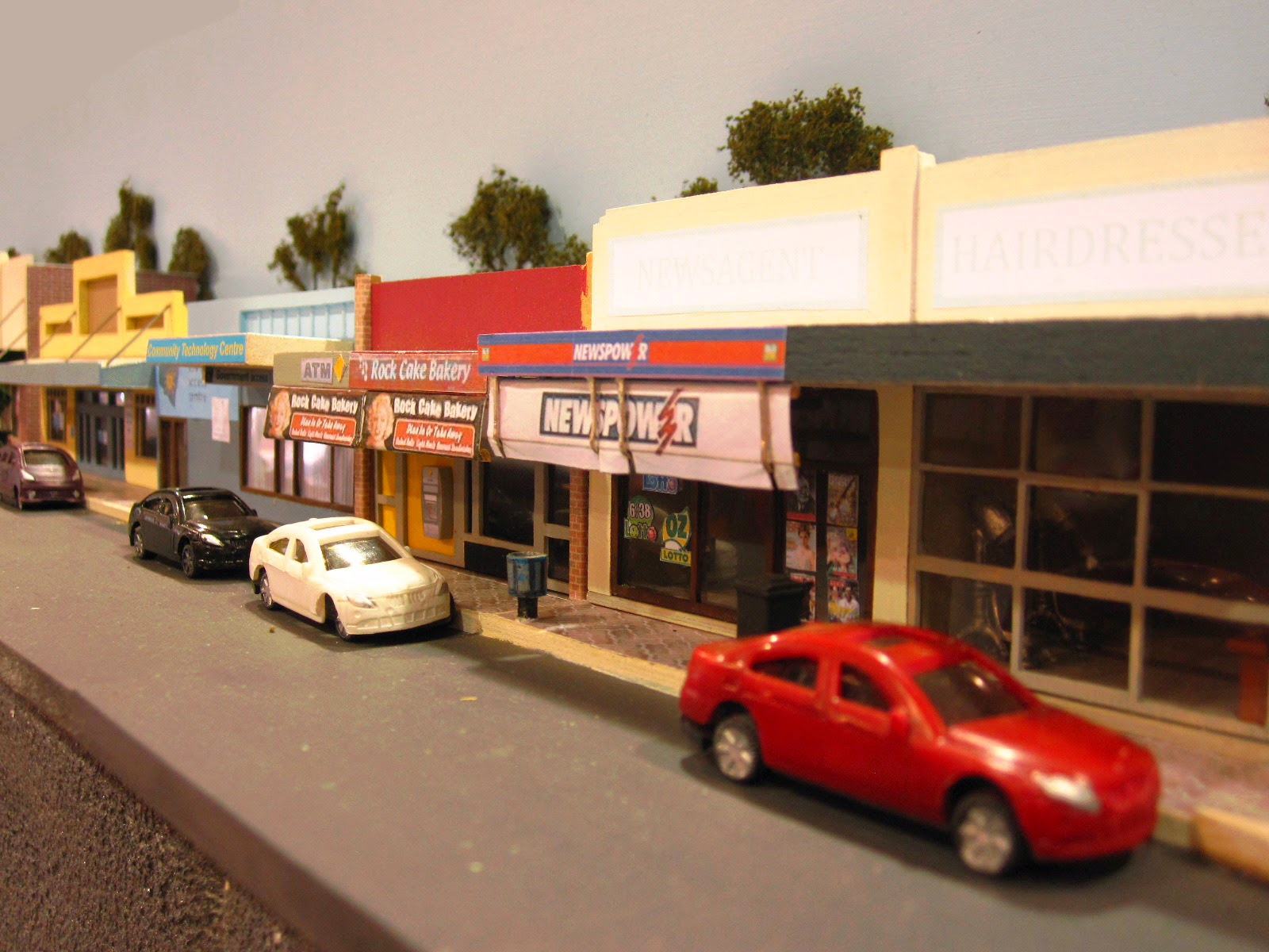 Quarter inch scale modern Australian town street scene with newsagents and cars parked outside.