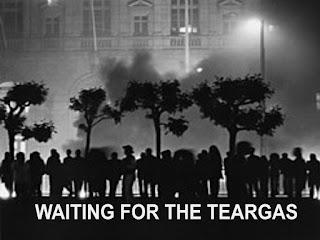 Facingthe riot police, From InText