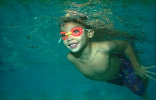 A Child swimming under was during swimming classes
