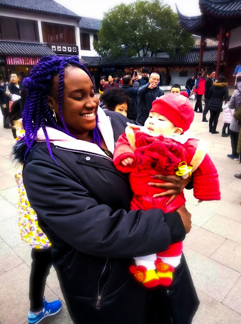 girl holding baby in China