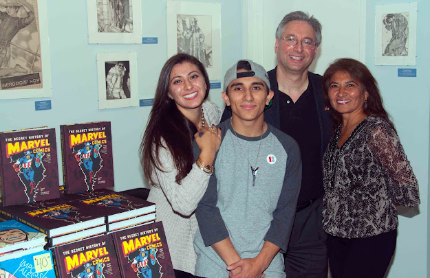 Mike and his family introduces his book