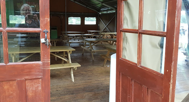 Knowsley Safari covered huts for eating and shelter with lots of chairs and tables