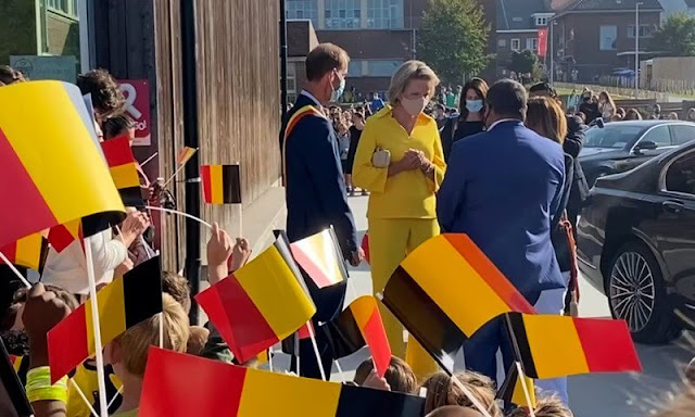 Queen Mathilde wore yellow silk shirt top and pants by Natan at primary school KAZ in Zottegem