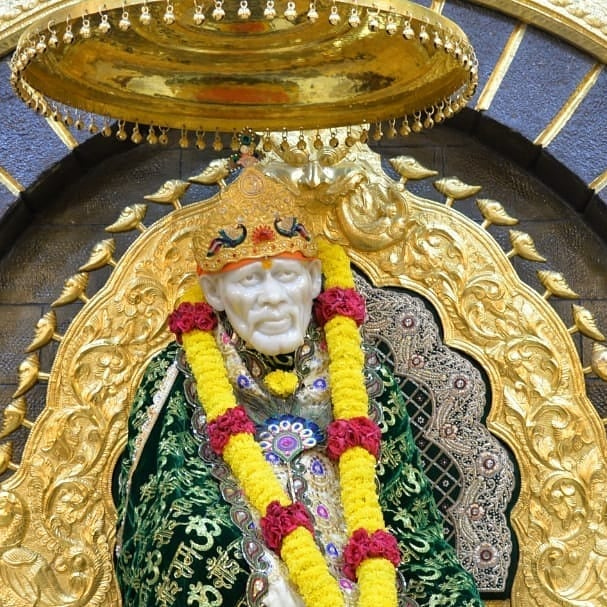 Black Color Clothes wear Sai baba in this images