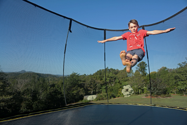child bouncing on trampoline