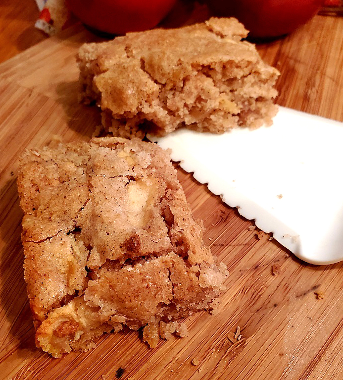 these are apple brownie on a wooden cutting board
