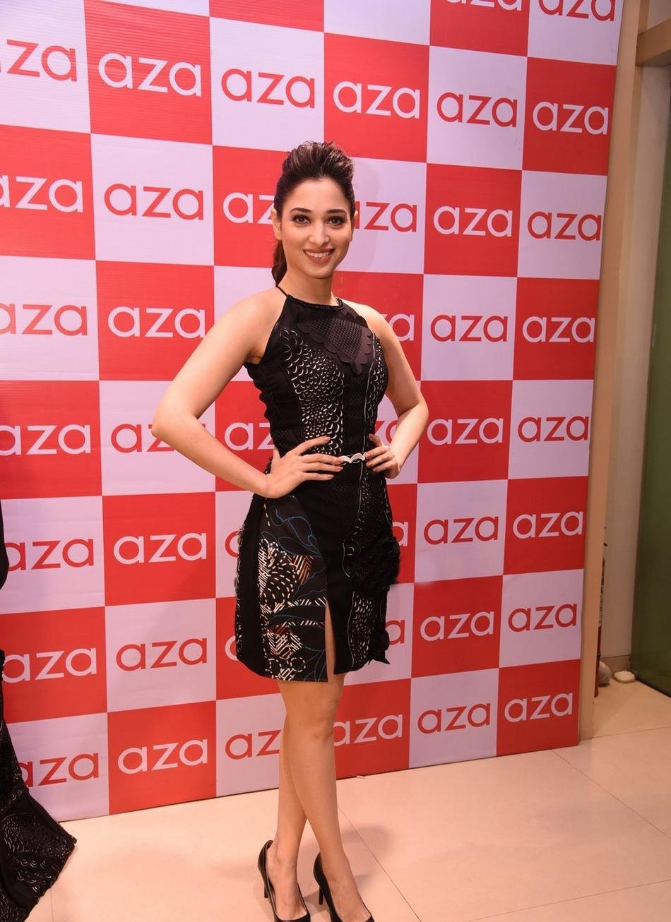 Actress Long legs Photos in Black Dress Tamannaah
