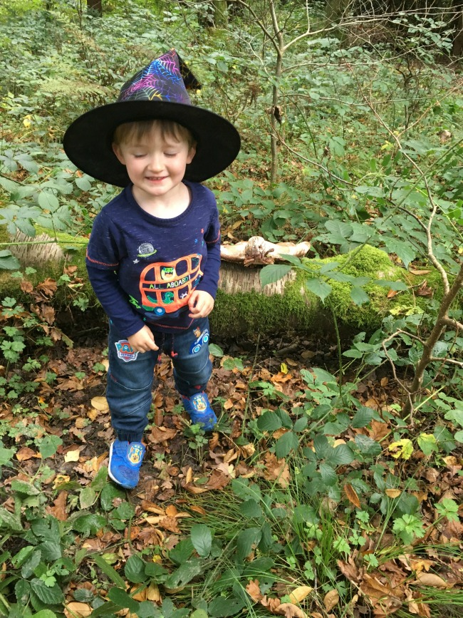 toddler-wearing-witches-hat-outside-saying-cheese