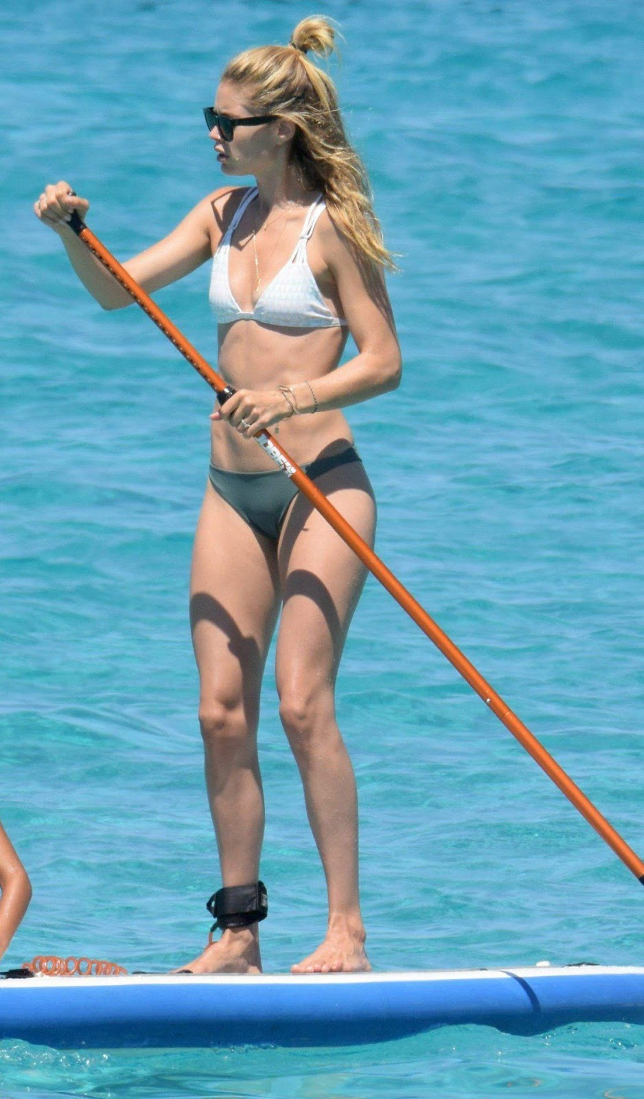 Doutzen Kroes flaunts pert posterior in thong bikini in Ibiza