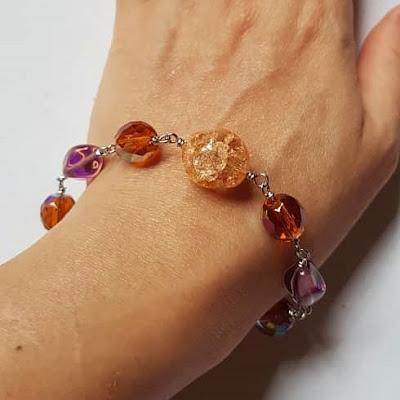 Wire Wrapped Fire Polished Glass Beads Bracelet on Shuku's Wrist