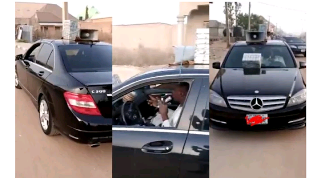 Nigerian Man Seen Selling herbs with microphone in a Benz c300 (Video)
