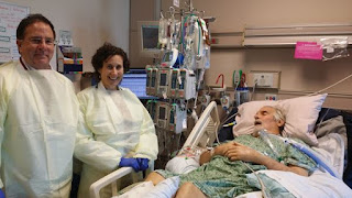 UC San Diego Health's Robert Schooley, MD, and Randy Taplitz, MD, administer intravenous experimental phage therapy for patient Tom Patterson in March 2016, four months after he contracted a multidrug-resistant bacterial infection in Egypt. Credit: UC San Diego Health