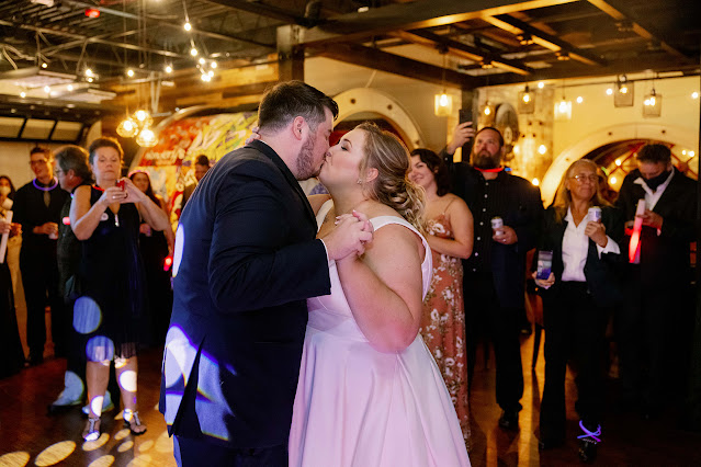 bride and groom kiss at first dance